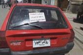 الاخوان تقوم بلصق منشورات تدعو للمقاطعة علي أبواب وسيارات المواطنين بالفيوم