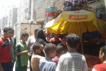 بالصور: نائبة حي غرب أسيوط ست 100 رأجل